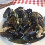 Mussels (0.5kg). Risotto dish in the background