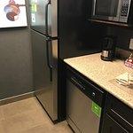Full fridge, very small microwave, dishwasher