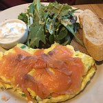Smoked salmon omelette with greens and organic bread