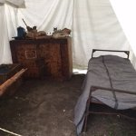 Tent accommodations of years gone by, with artifacts.