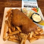 Fish and chips, served with fries, tartar sauce and cole slaw