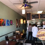 Featuring Local Artist's, these paintings add even more color to Kouzina's Authentic Greek Fare.