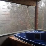 2 person spa upstairs with views to the rainforest