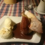 Pear served with Chocolate sauce and Vanilla icecream