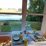 Breakfast room overlooking pond