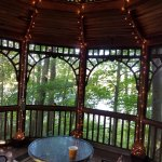 Twinkly light private gazebo overlooking pond