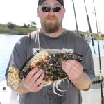 My Son, Tony with his Flounder. He was stoked!!!