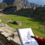 Russell the Muscle telling us about the original sun dial at Machu Pichu.