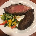 Prime Rib with mixed vegetables and baked potato