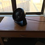 This is your work desk and that fan is the room's air conditioning unit.