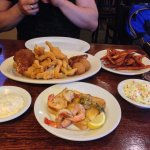 seafood platter with sweet fries, coleslaw, and grilled shrimp