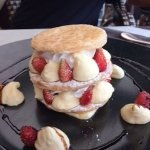Wild strawberries in a cream pastry