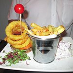 Chargrilled Gourmet Prime Fillet Steak Burger with double fried fries onion rings and slaw