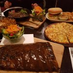 Ultimate onion, full rack of sweet and smokey ribs, garlic pizza, T-bone steak, Bush burger