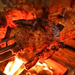 Chicken on wood fired grill
