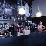 Well stocked bar and hansom barman.