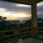 View from room balcony to the beach over sunset