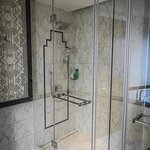 Shower with rain shower and normal shower head.
