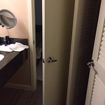 the bathroom door intrudes into the vanty space creates congestion in the space with the closet