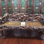 Carved bench in front of Jade screen.
