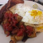 Sausage gravy on homemade biscuits, eggs, roasted potatoes, and a side of crispy bacon!