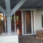 View of the door to the room and porch