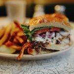 Juicy Lucy burger alongside sweet potato fries.