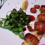 Scallops wrapped in Parma ham and mild mushrooms in pepper sauce