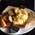 Seafood omelet with breakfast potatoes and toast