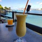 Mango and Coconut Smoothie (front) - Fresh Orange Juice (back)