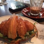 Braised greens, onion & raclette toasted croissant