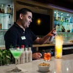 Enjoy a cocktail or glass of wine at the full bar inside Maderas