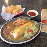 My favorite, the chicken burrito smothered with hot green chili with rice and beans