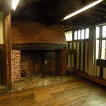 The ground floor parlour inglenook fireplace - note the wall of glazing!