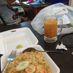 Shrimp fried rice and iced tea!!! yummy!! spring rolls and morning glory for take away! yummy!
