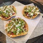 Taco-like starter with tomato and horse-radish