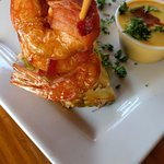 bacon wrapped shrimp on pineapple
