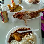 Huge Red snapper ... rice.... tostones ... and ice cold Medalla