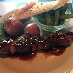Teriyaki beef kabab, with red skin potatoes, snap peas, and garlic bread