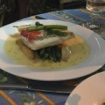 Ocean Snapper cooked in parchment with a burre sauce