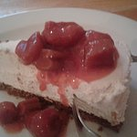 Cheesecake with strawberry, rhubarb topping