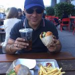 Enjoying Famous California Burger with Fries and chilled Coke..