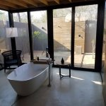 indoor and outdoor shower, tub, all open and airy but very private
