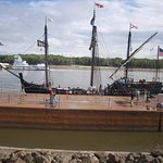 The Pinta with Mississippi River traffic in background.