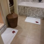 Rose petals by the bed and in the ensuite.
