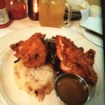 Buttermilk fried chicken with collards and mashed potato. Lemonade cocktail
