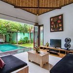 Formal living area with pool and garden view