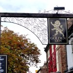 Unusual   pub sign  on distinct timber  and metal structure  in front of pub