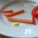 dried out and curling carrot sticks with child's meal
