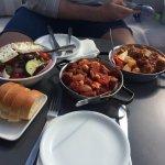 Sausage & beef stews, greek salad & bread